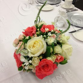 Table setting- roses and silver chargers.