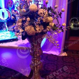 Giant sparkle vases with dramatic floral arrangement.