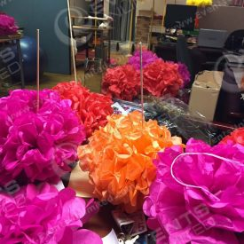 Building paper flowers and umbrellas in our office...
