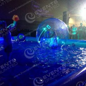 Custom Indoor Pool with floating sphere and interpretive dance performance.