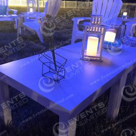 Some decor and seating area under the lounge tent for the hamptons event.