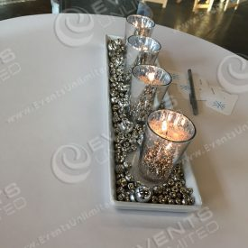 This mercury glass candle centerpiece was put together by our in house decor team.
