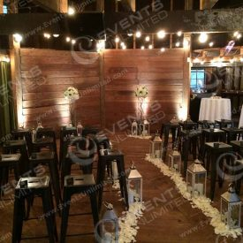 We transformed this old barn into a beautiful wedding chapel- provided bistro lighting, cool stools, floral, lighting, and more!