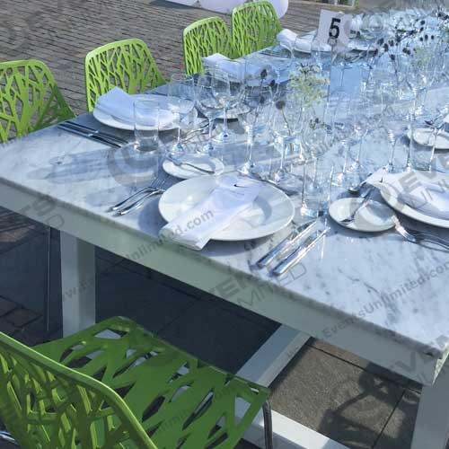 table with green chairs